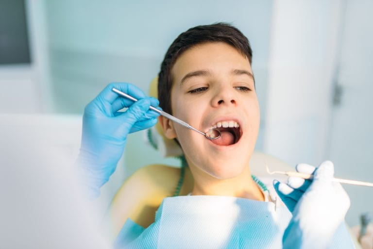 Boy With Open Mouth In A Dental Chair 57vw9l8 Min 768x513