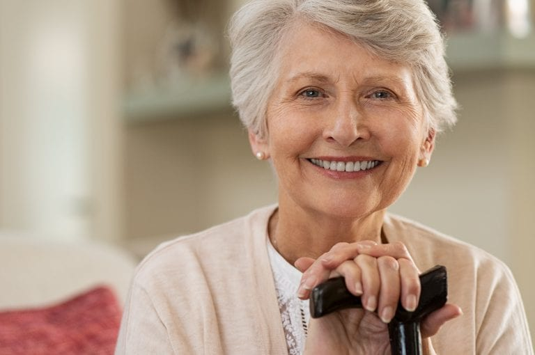 Elderly Woman Smiling At Home Rmnw6bq Min 768x510